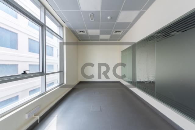 semi-furnished office for rent in al garhoud, al nisf building   4