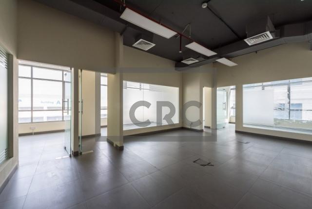 semi-furnished office for rent in al garhoud, al nisf building   7