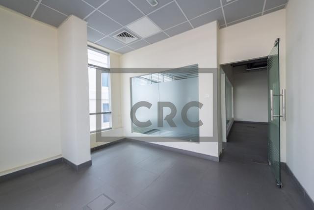 semi-furnished office for rent in al garhoud, al nisf building   9
