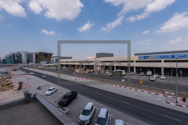 semi-furnished office for rent in al garhoud, al nisf building   18