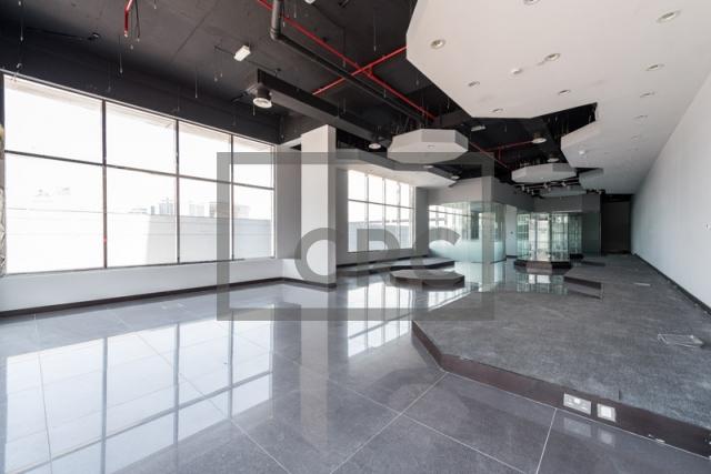 retail for rent in al garhoud, al nisf building   4