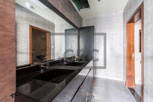 show room for rent in al garhoud, al nisf building   4