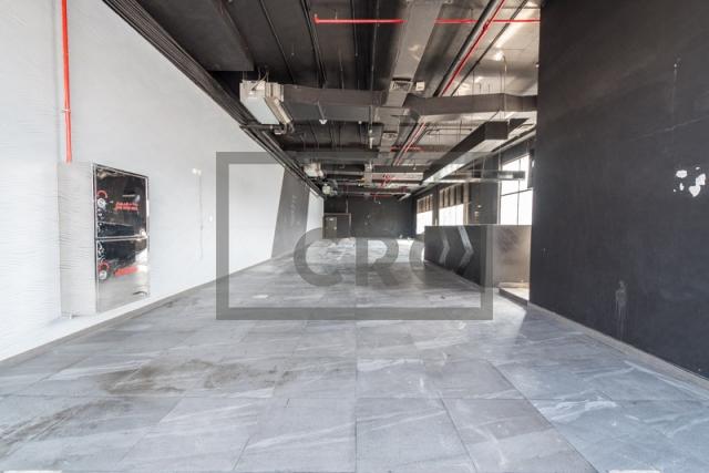 show room for rent in al garhoud, al nisf building   5
