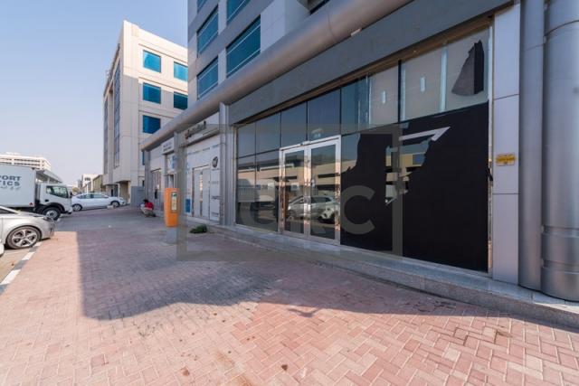 show room for rent in al garhoud, al nisf building   7
