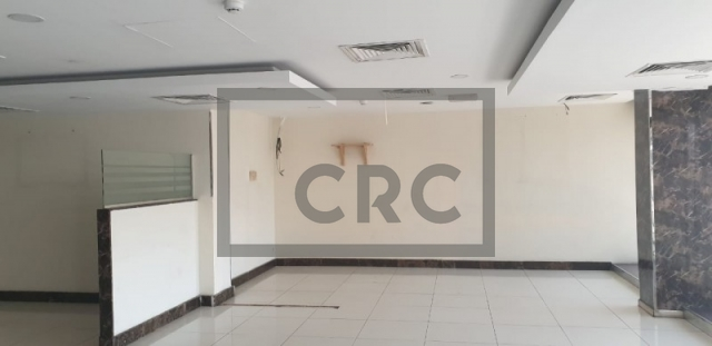 retail for rent in karama, yellow building   1