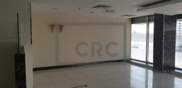 retail for rent in karama, yellow building   8