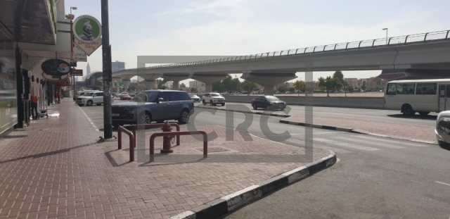 retail for rent in karama, yellow building   7