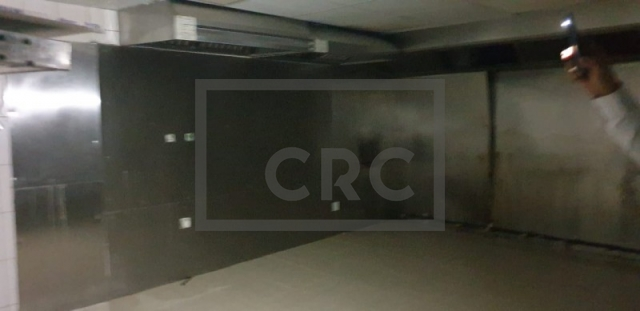 retail for rent in karama, yellow building   5