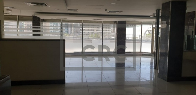retail for rent in karama, yellow building   3