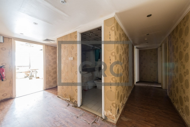 office for rent in karama, yellow building | 1