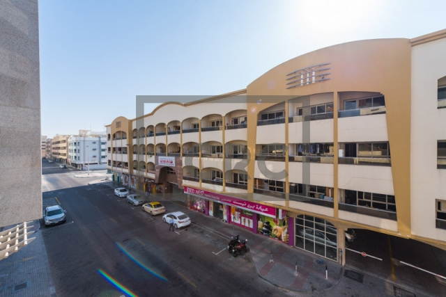 office for rent in karama, yellow building | 10