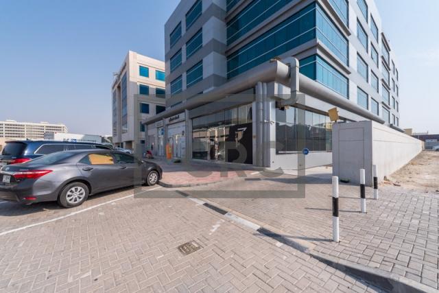 semi-furnished office for rent in al garhoud, al nisf building | 12