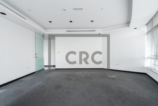 semi-furnished office for rent in al garhoud, al nisf building | 1