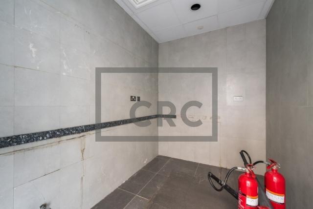 semi-furnished office for rent in al garhoud, al nisf building | 7