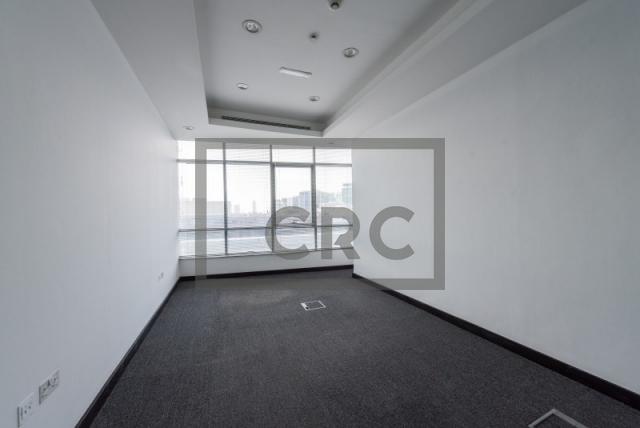 semi-furnished office for rent in al garhoud, al nisf building | 9