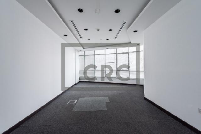 semi-furnished office for rent in al garhoud, al nisf building | 2