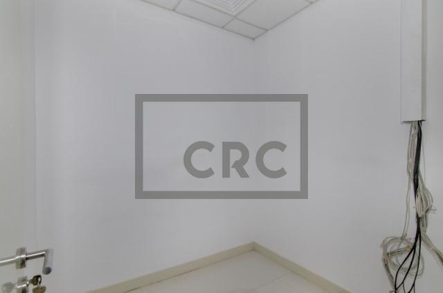 retail for rent in al garhoud, al nisf building   12