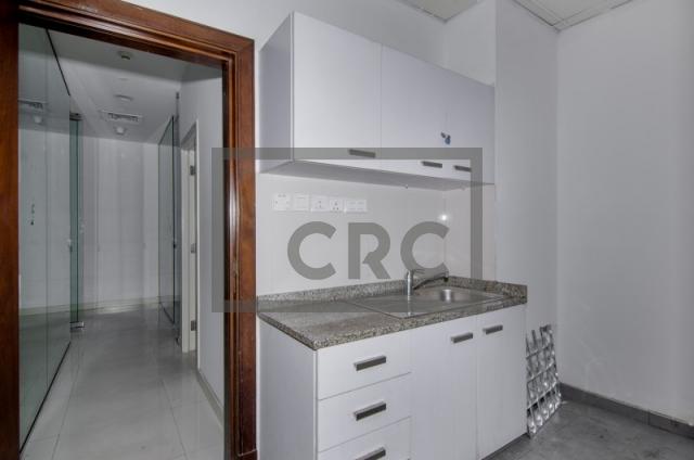 retail for rent in al garhoud, al nisf building   6